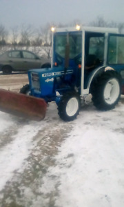 """""""The Perfect little tractor and blower combo"""""""