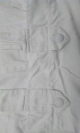 Large bay window cream.tabtop curtains