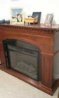 beautiful cherry wood fire place with electric insert.
