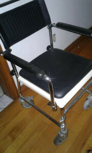 Commode  19 x 15 with arms that swing up for convenience