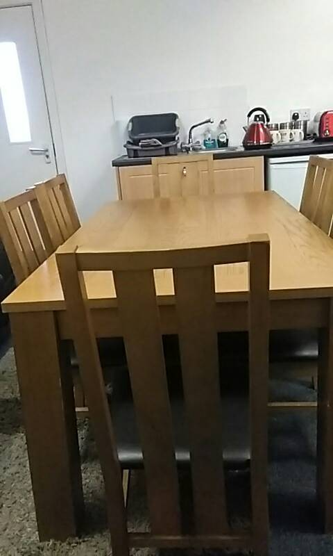 SOLID WOODEN TABLE AND 6 CHAIRS FOR SALE