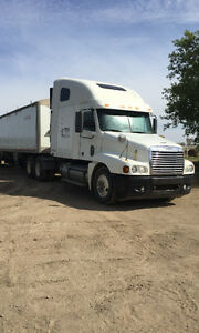 2005 freightliner Columbia addition & 2015 Wilson grain trailer