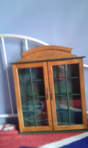 Wooden cabinet that hangs on wall