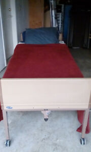 LIKE NEW INVACARE BED *MATTRESS NEVER TOUCHED!*