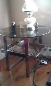 Two matching glass end tables