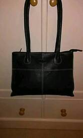 OSPREYS DESIGNER HANDBAG, IN HAND TOOLED ITALIAN LEATHER, IN BLACK ,WITH WHITE CONTRAST STITCHING