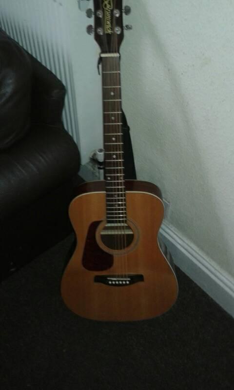 Oringinal leftie Brunswick acoustic guitar