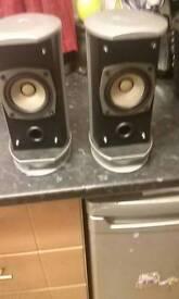 two silver black jvc speakers