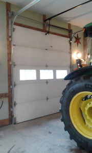 Two year old  Garaga garage door with insulated windows..