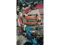 Assortment ov mowers hedgecutters and saws and wheeled strimmer ect