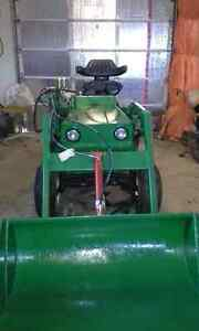 Small tractor with front end loader
