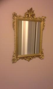 small gold framed mirror