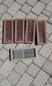 Floor registers in brown and taupe.