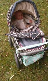 Lovely big good quality toy baby's pram and baby
