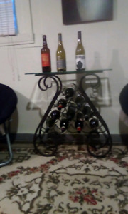 Wrought iron wine stand with beveled glass top