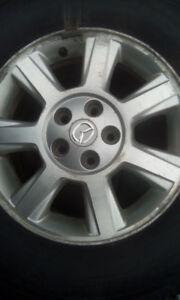 4 pneus hiver Michelin Latitude sur mag 235/70R16 servi 2 hivers