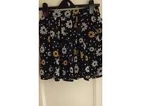Age 11-12 Tesco floral lined skirt