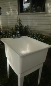 LAUNDRY TUB WITH TAPS ( good condition)