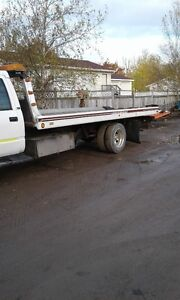 flat deck tow truck with weel lift good shape works good 10500 o