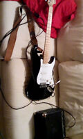 Starcaster with new strings and amp, perfect beginner set