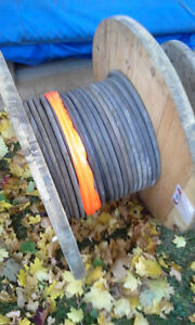 SPOOL OF 3/4 INCH STEEL CABLE, never used. 278 FEET $$ REDUCED