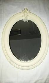 Lovely oval mirror with Cupid