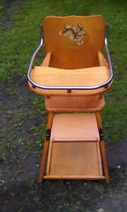 NICE HARDWOOD BABY CHAIR/FOLDS INTO TABLE WITH WHEELS $75
