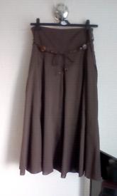 Size 14 lightweight brown cotton longer skirt. Lined. Worn twice.