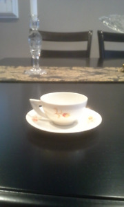 3 different sets of expresso coffee cups and saucers