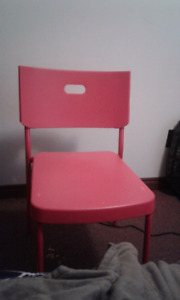 2 plastic red chairs and white kitchen table  from ikea