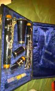 B flat clarinet, and music book