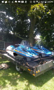 Two 1988 polaris indy sport with trailer