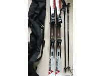 Skis, poles and travel bag