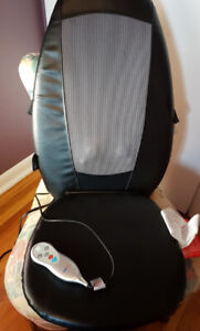 Obusforme massaging cushion with heat
