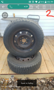 P215/70R15 Avalanche X-Treme snow tires on steal rims .