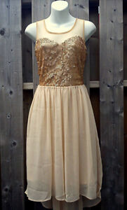 New with Tags! Romeo & Juliette Couture Gold Sheer Back Dress
