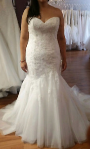 Beautiful designer wedding dress in excellent condition