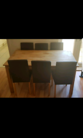 Oak dining table and 6 chairs Wooden seating stools rug