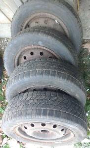 "Nordic Ice Trak snow tires on 14"" rims"