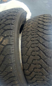 4 235/65/17 Goodyear directional snow tires.