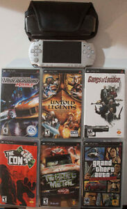 PSP-2001 with 8 games. Case included. Charger not included.