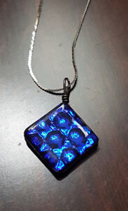 Shiny blue pendant with 14k white gold chain.