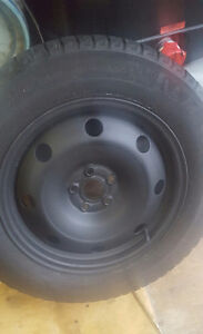 Selling 4 215/60/16 michelin ice tires and rims