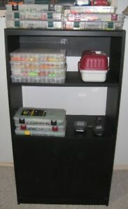 Storage cabinet organizer for fishing hunting and outdoor gear