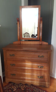 Antique dresser with adjustable swing mirror