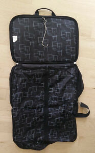 2 smaller Tracker garment bags with lots of compartments