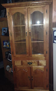 Corner cabinet with table and chairs