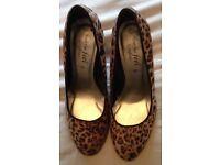 Size 7 faux leopard print heels