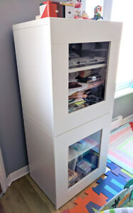 4 stackable storage boxes, with glass doors, great condition!