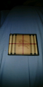 Authentic used burberry men's wallet.